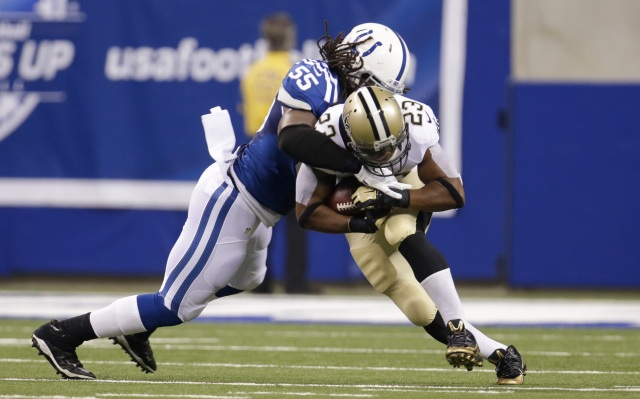 Indianapolis Colts inside linebacker Kelvin Sheppard, left, tackles New Orleans Saints running back Pierre Thomas. (AP Photo/AJ Mast)
