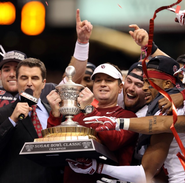 This is Bob Stoops holding a trophy after his team walloped Alabama. (Chuck Cook, USA TODAY Sports)