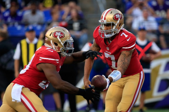 49esr rookie RB Carlos Hyde, left, had a solid NFL debut. (Rob Carr-Getty Images)