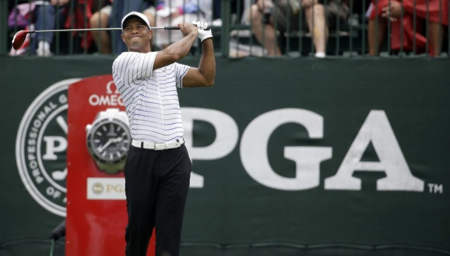 Tiger Woods' first drive of  the day was off line, and he has a lot of work to do.  (Jeff Roberson, AP Photo)