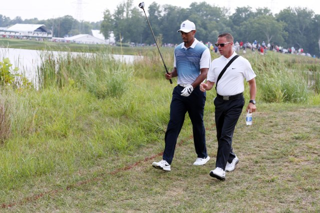 Tiger Woods talks with his now-former coach Sean Foley (Brian Spurlock-USA TODAY Sports)