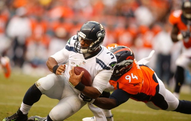Broncos defensive end DeMarcus Ware (94) sacks Seattle Seahawks quarterback Russell Wilson. (Chris Humphreys-USA TODAY Sports)