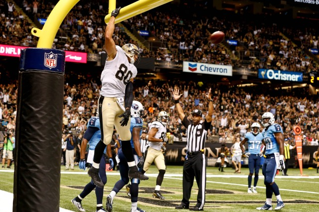 Jimmy Graham (80) celebrates by dunking over the goalpost following a touchdown against the Tennessee Titans. (Derick E. Hingle-USA TODAY Sports)
