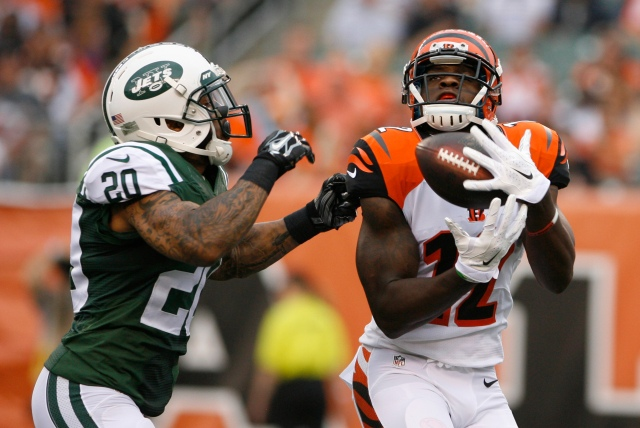 Mohamed Sanu (12) scores a touchdown against New York Jets cornerback Kyle Wilson (20). (Mark Zerof-USA TODAY Sports)
