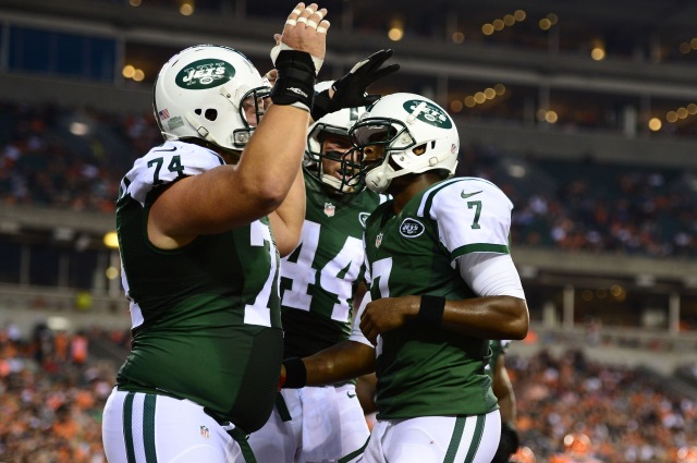 Geno Smith (7) celebrates with center Nick Mangold (74) after scoring a touchdown during the second quarter against the Cincinnati Bengals. (Andrew Weber-USA TODAY Sports)