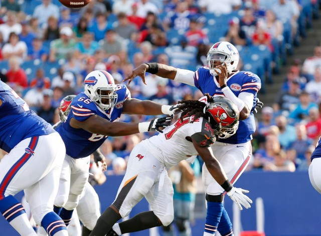 Buffalo Bills quarterback EJ Manuel (3) is hit by Tampa Bay Buccaneers defensive end Adrian Clayborn (94). (Kevin Hoffman-USA TODAY Sports)