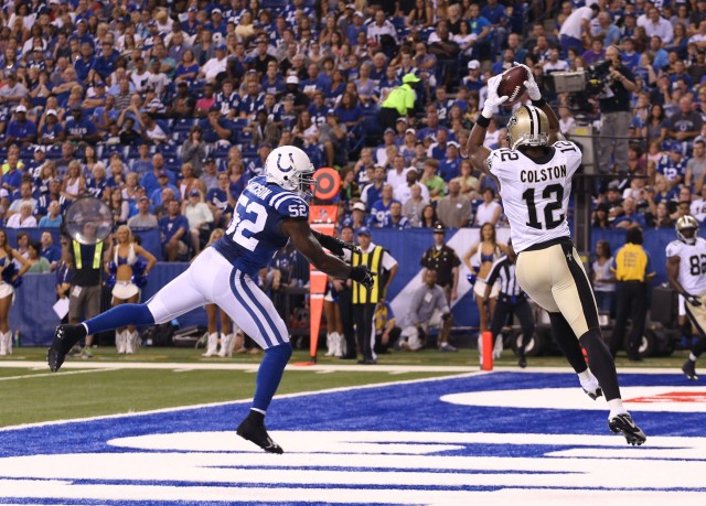 New Orleans Saints wide receiver Marquis Colston (12) catches a pass in the end zone for a touchdown against Indianapolis Colts linebacker D'Qwell Jackson (52). (Brian Spurlock-USA TODAY Sports)