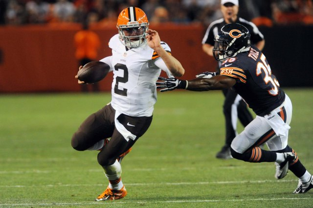 Cleveland Browns quarterback Johnny Manziel (2) runs from Chicago Bears safety Marcus Trice. (Ken Blaze-USA TODAY Sports)