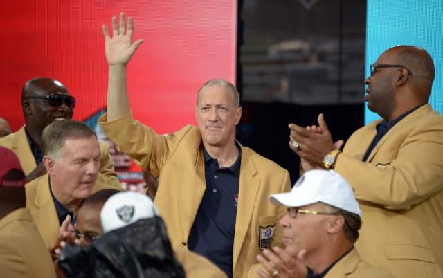 Jim Kelly waves to the crowd at the 2014 Pro Football Hall of Fame Enshrinement at Fawcett Stadium. (Credit: USA TODAY Sports)