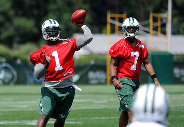 Michael Vick (left) will have to impress to overtake Geno Smith (right). (Rich Barnes, USA TODAY Sports)