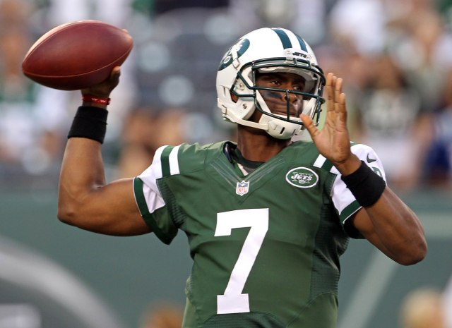 Geno Smith has every advantage in the Jets' QB race, but Michael Vick is still around. (Adam Hunger, USA TODAY Sports)
