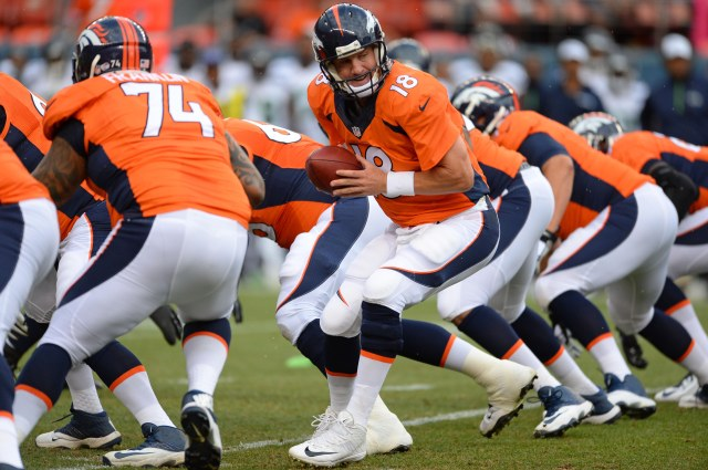 Peyton Manning led the Broncos on a nine-minute TD drive Thursday. (Ron Chenoy-USA TODAY Sports)