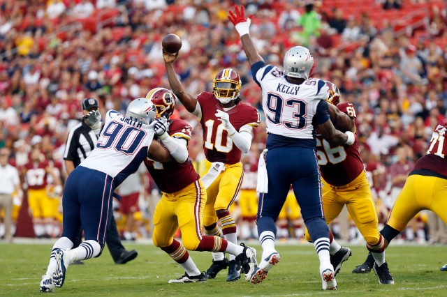 Washington Redskins quarterback Robert Griffin III (10) throws the ball against the New England Patriots in the first quarter at FedEx Field. (Geoff Burke-USA TODAY Sports)