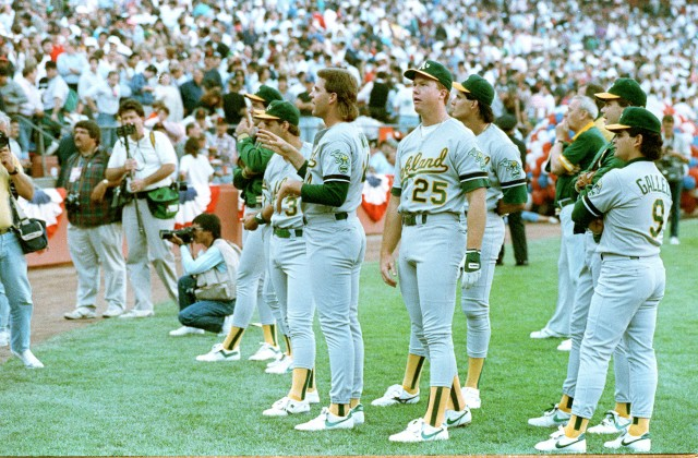 Members of the Oakland Athletics stand and stare as Candlestick Park-goers leave the stadium in the wake of the major earthquake that struck Northern California just before game 3 of the World Series against the San Francisco Giants on Oct. 17, 1989.   (AP Photo)
