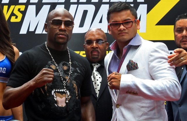 Floyd Mayweather, left, wants to go out on his terms, but must get through a rematch with Marcos Maidana first. (Noah K. Murray, USA TODAY Sports)