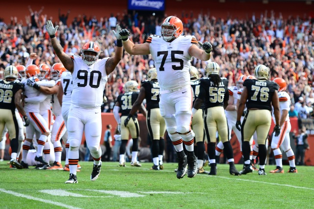 Cleveland Browns defensive end Billy Winn (90) and guard Joel Bitonio (75) celebrate after Billy Cundiff (not pictured) kicked the game winning field goal to defeat the New Orleans Saints. (Andrew Weber-USA TODAY Sports)