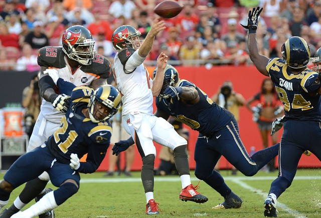 Tampa Bay Buccaneers quarterback Josh McCown (12) throws a pass against the St. Louis Rams. (Jonathan Dyer-USA TODAY Sports)