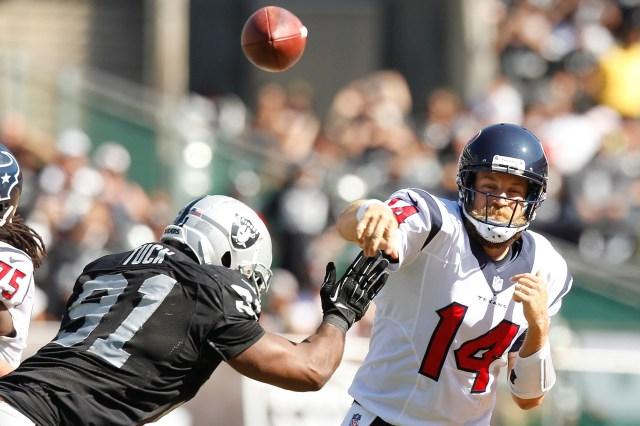 Houston Texans quarterback Ryan Fitzpatrick (14) throws a pass over Oakland Raiders defensive end Justin Tuck (91). (Edmondson-USA TODAY Sports)