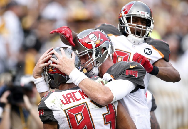 The Tampa Bay Buccaneers celebrate a game winning touchdown catch by wide receiver Vincent Jackson (83) against the Pittsburgh Steelers. The Buccaneers won 27-24. (Charles LeClaire-USA TODAY Sports)