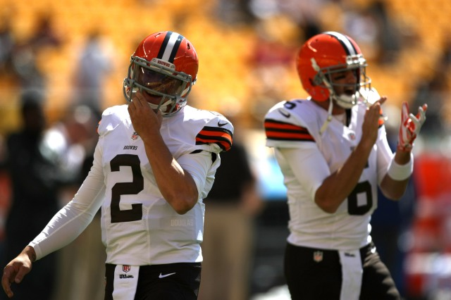 Johnny Manziel, left, was on the sidelines in the first half as Brian Hoyer struggled for the Cleveland Browns.