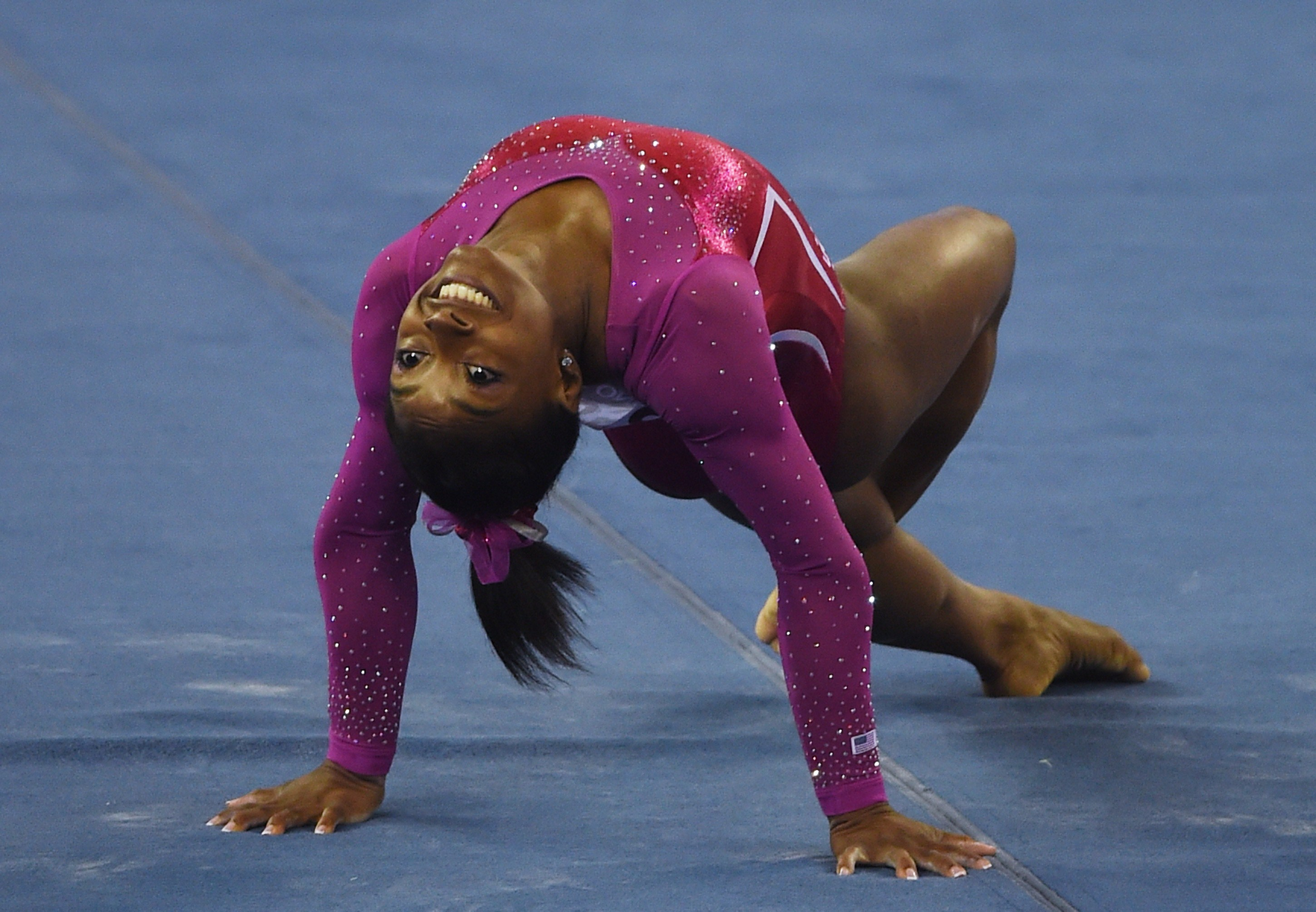 Simone Biles of the US completes her final routine to win  the women's all-around. (AFP PHOTO/Greg BAKERGREG BAKER/AFP/Getty )