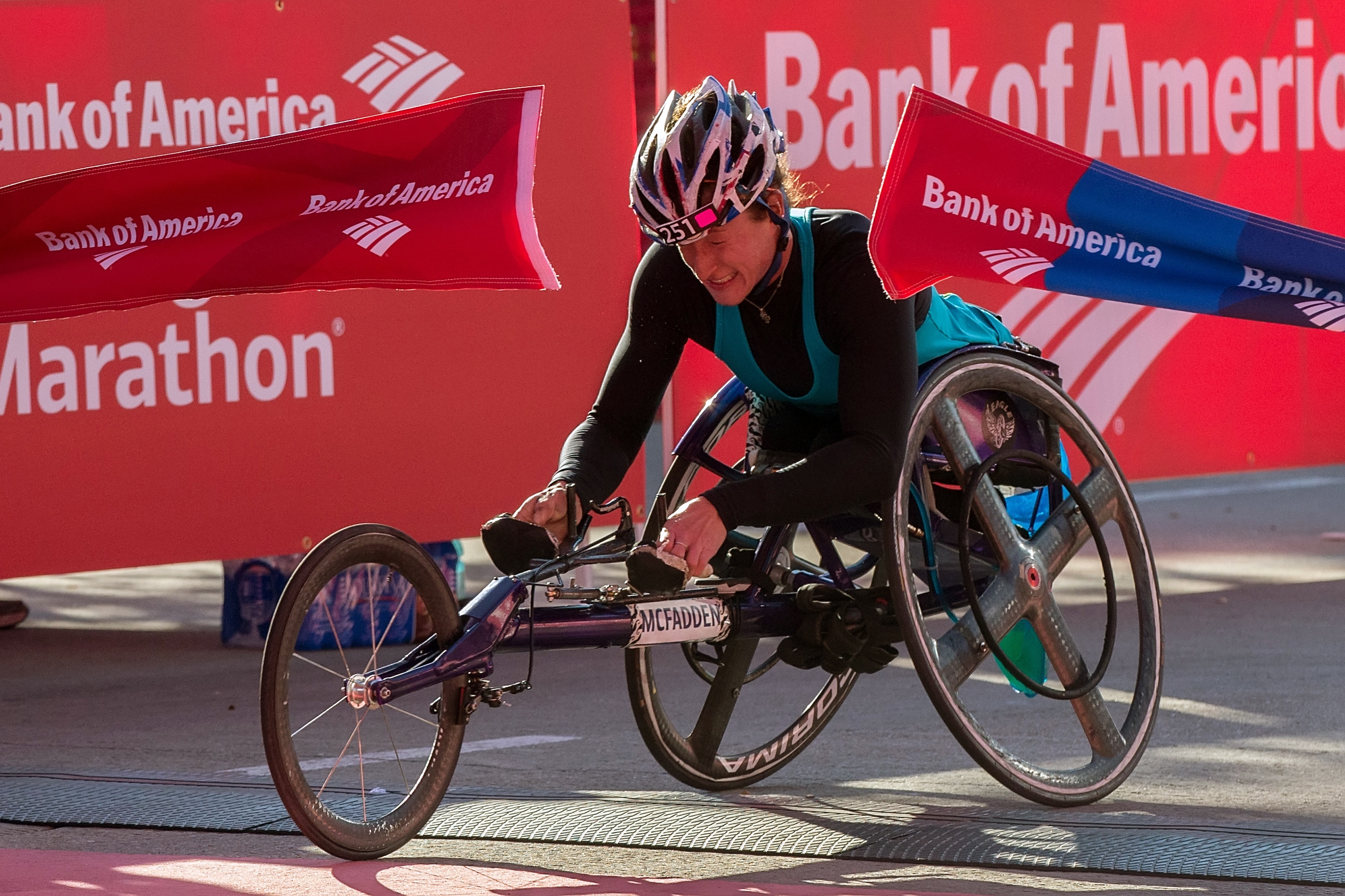 Tatyana McFadden crosses the finish line to win the women's wheelchair race during the Chicago Marathon on Sunday, Oct. 12, 2014, in Chicago. Chicago's 37th annual race included a field of 108 elite men, women and wheelchair athletes. (AP Photo/Andrew A. Nelles)