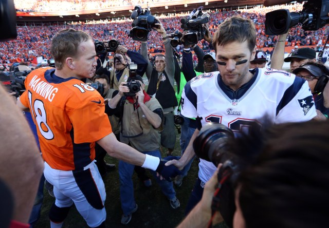 Broncos quarterback Peyton Manning (18) and New England Patriots quarterback Tom Brady (12) shake hands after the 2013 AFC championship playoff football game. (Matthew Emmons-USA TODAY Sports)