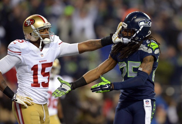 Seattle Seahawks cornerback Richard Sherman (25) gets shoved in the face by San Francisco 49ers wide receiver Michael Crabtree (15) while trying to shake hands after an interception by Seahawks outside linebacker Malcolm Smith (not pictured) during the second half of the 2013 NFC Championship football game. (Kirby Lee-USA TODAY Sports)