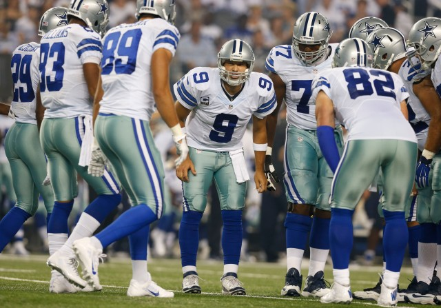 Dallas Cowboys quarterback Tony Romo (9) calls the play in the huddle. (Matthew Emmons-USA TODAY Sports)