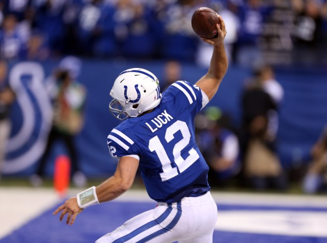 Indianapolis Colts quarterback Andrew Luck (12) spikes the ball after scoring a touchdown against the Baltimore Ravens. (Brian Spurlock-USA TODAY Sports)