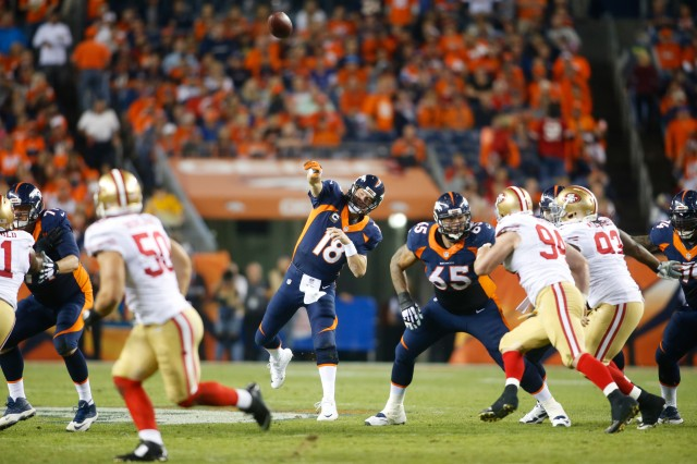 Denver Broncos quarterback Peyton Manning (18) throws for a touchdown in the third quarter against the San Francisco 49ers. (Chris Humphreys-USA TODAY Sports)