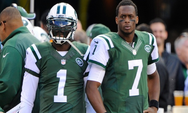New York Jets quarterback Geno Smith (7) stands beside quarterback Michael Vick (1) after being benched in the first half against the Buffalo Bills. (Robert Deutsch-USA TODAY Sports)