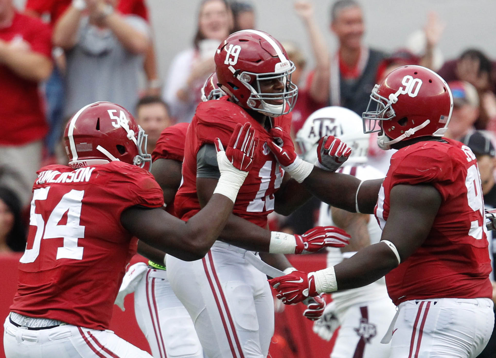 Alabama players celebrate an interception against Texas A&M. (Marvin Gentry, USA TODAY Sports)