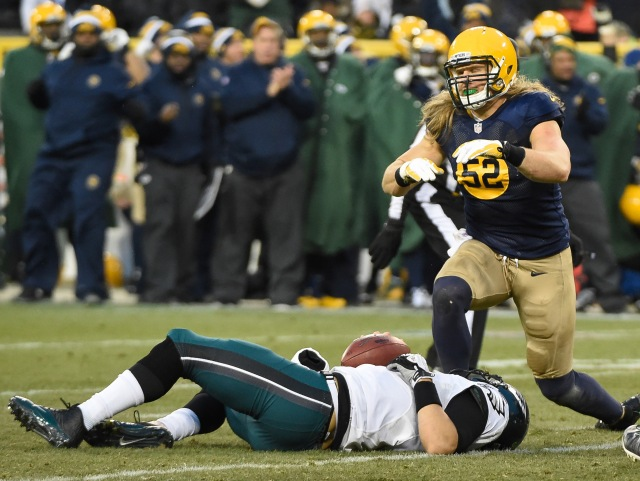 Green Bay Packers linebacker Clay Matthews (52) reacts after sacking Philadelphia Eagles quarterback Mark Sanchez (3) in the second quarter. (Benny Sieu, USA TODAY Sports)