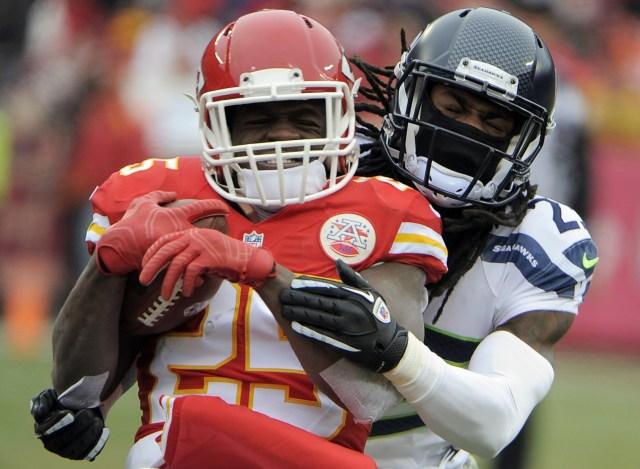 Seattle cornerback Richard Sherman tackles Chiefs running back Jamaal Charles. John Rieger, USA TODAY Sports)
