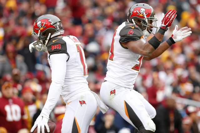 Buccaneers wide receiver Mike Evans (13) celebrates with Buccaneers running back Charles Sims (34) after scoring a touchdown. (Geoff Burke, USA TODAY Sports)