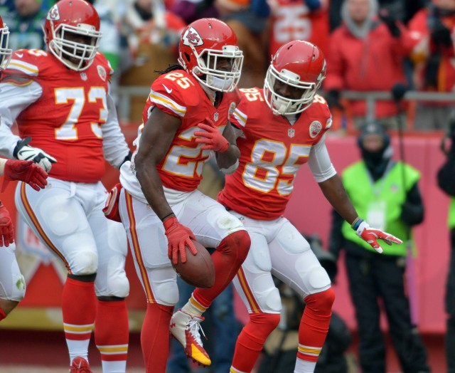 Kansas City Chiefs running back Jamaal Charles (25) is congratulated by wide receiver Frankie Hammond (85) after scoring  a touchdown during the first half against the Seattle Seahawks. (Denny Medley-USA TODAY Sports)