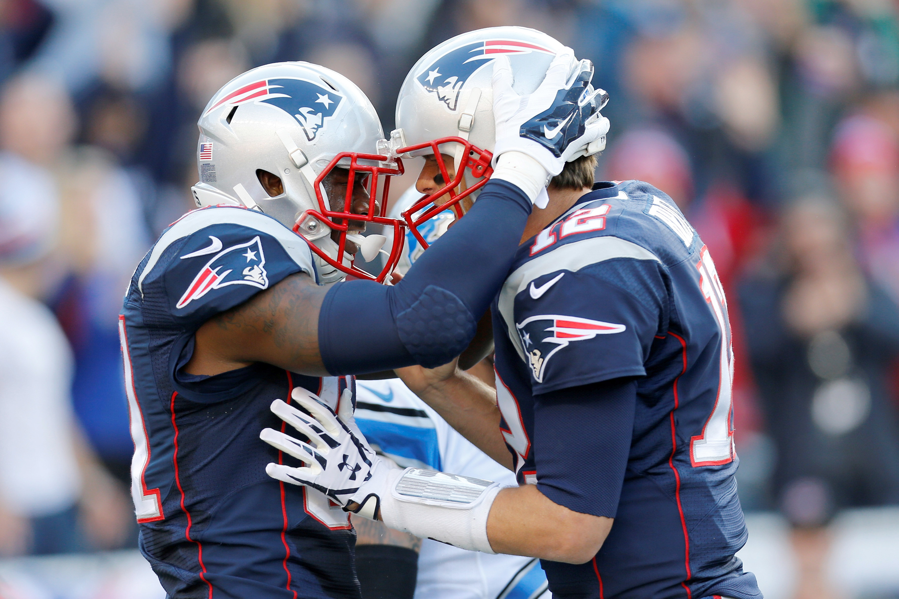 Tom Brady (12) congratulates tight end Tim Wright (81) after a touchdown during the second quarter against the Detroit Lions at Gillette Stadium. (Greg M. Cooper-USA TODAY Sports)