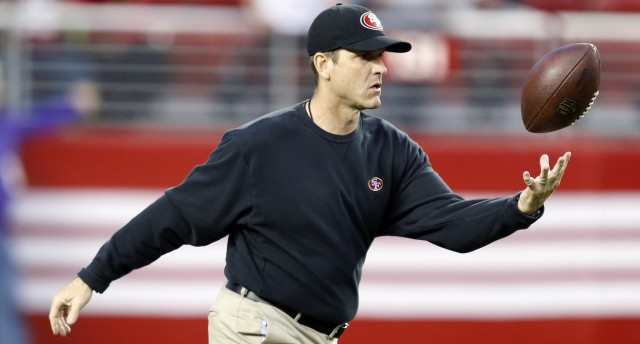 Jim Harbaugh's football catching skills are among his many desirable coaching traits. (Bob Stanton, USA TODAY Sports)