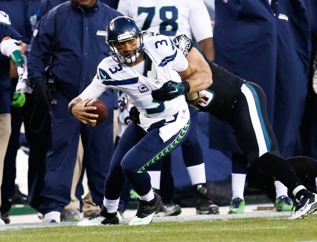 Russell Wilson threw for two touchdowns and ran for another. (Bill Streicher, USA TODAY Sports)