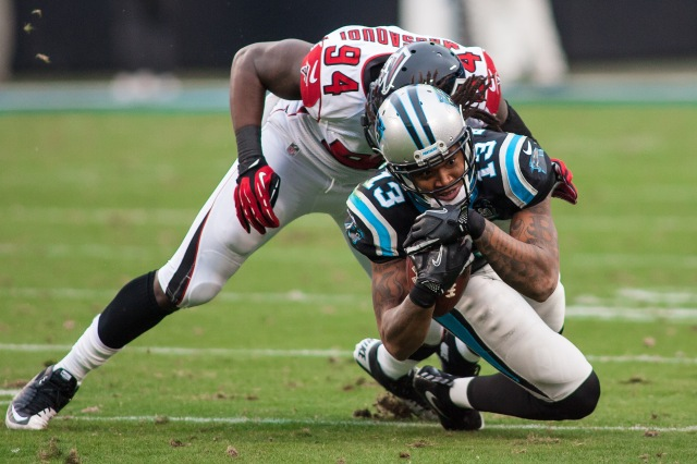 Carolina Panthers wide receiver Kelvin Benjamin (13) is tackled by Atlanta Falcons outside linebacker Jonathan Massaquoi. (Jeremy Brevard-USA TODAY Sports)