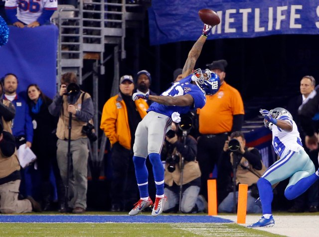 New York Giants wide receiver Odell Beckham (13) pulls in touchdown pass  against the Dallas Cowboys. (Jim O'Connor-USA TODAY Sports)