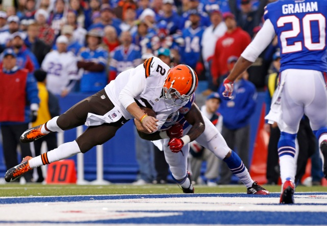 Cleveland Browns quarterback Johnny Manziel (2) scores a touchdown as Buffalo Bills outside linebacker Nigel Bradham. (Kevin Hoffman-USA TODAY Sports)