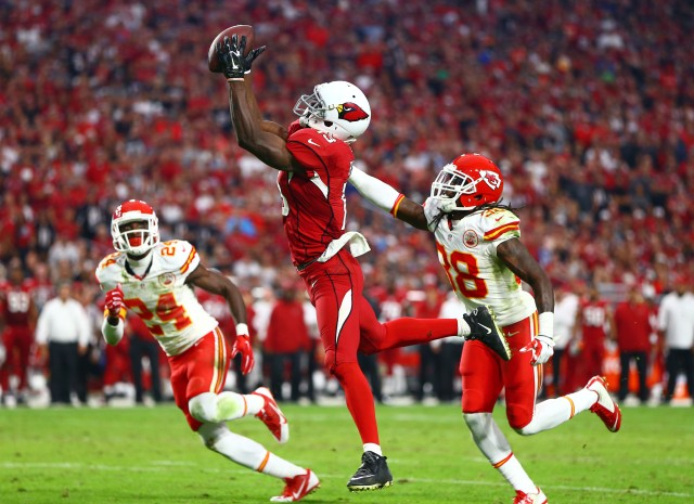 Arizona Cardinals wide receiver Jaron Brown (13) catches a touchdown pass in the third quarter against the Kansas City Chiefs. (Mark J. Rebilas-USA TODAY Sports)
