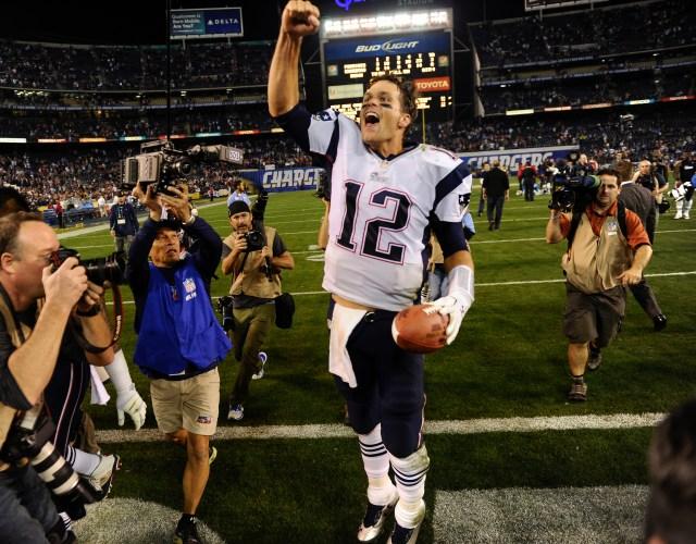 New England Patriots quarterback Tom Brady (12) celebrates his teams 23-14 win over the San Diego Chargers. (Robert Hanashiro-USA TODAY Sports)