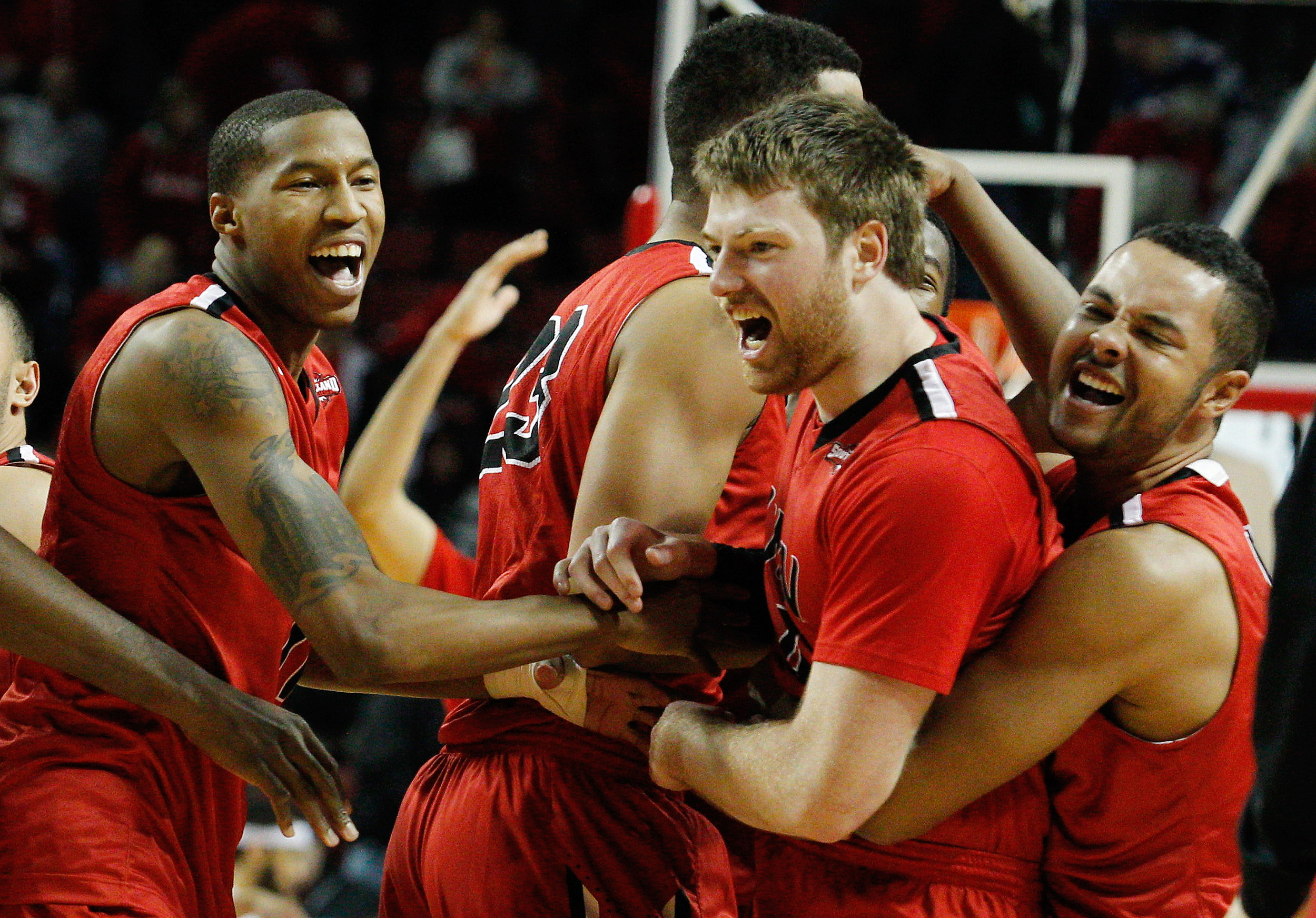 Incarnate Word Cardinals  guard Kyle Hittle (4) celebrates with teammates after defeating the Nebraska Cornhuskers in the second half at Pinnacle Bank Arena. Hittle scored the game-winning basket in the final seconds of the game. Incarnate Word won 74-73. (Bruce Thorson-USA TODAY Sports)
