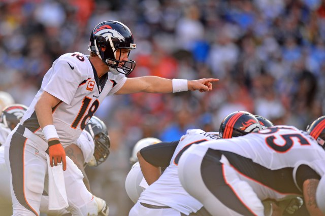 Denver Broncos quarterback Peyton Manning (18) gestures against the San Diego Chargers. (Jake Roth-USA TODAY Sports)