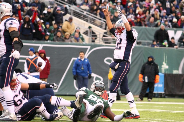 New England Patriots quarterback Tom Brady (12) reacts after a touchdown against the New York Jets. (Brad Penner-USA TODAY Sports)
