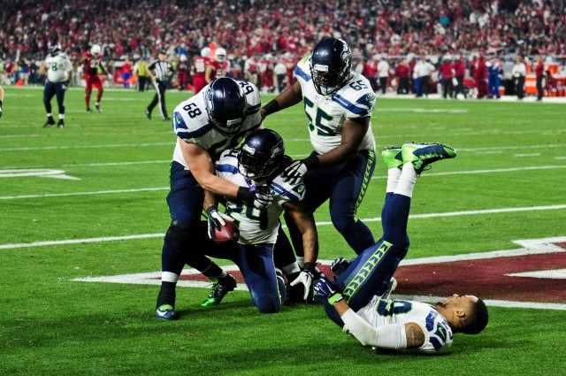 Seattle Seahawks running back Marshawn Lynch (24) celebrates with tackle Justin Britt (68), center Patrick Lewis (65) and free safety Earl Thomas (29) after a 79 yard touchdown. (Matt Kartozian-USA TODAY Sports)