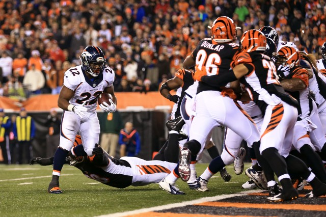 Denver Broncos running back C.J. Anderson (22) runs into the end zone for a touchdown during the third quarter against the Cincinnati Bengals. (Andrew Weber-USA TODAY Sports)